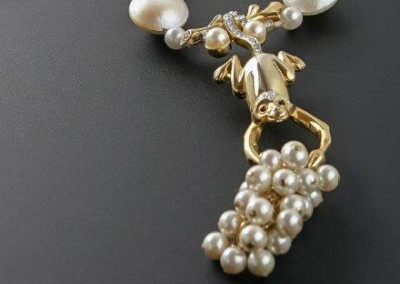Vintage Monkey Pin Holding Pearls